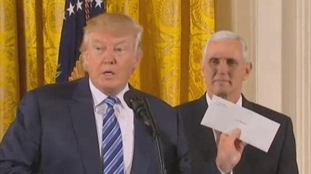 Donald Trump shows off 'secret' Obama letter