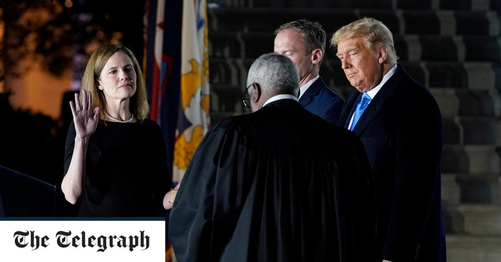 Amy Coney Barrett: Supreme Court judge sworn in as Donald Trump hails 'momentous day for America'