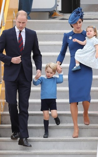The royal blues: The Duchess of Cambridge wears Jenny Packham for a matchy-matchy family fashion moment in Canada