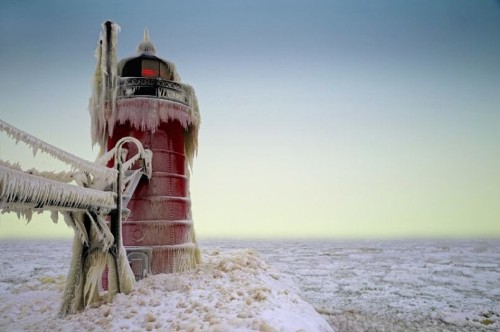 Bizarre ice formations engulf frozen lighthouse in Michigan, in pictures - Telegraph