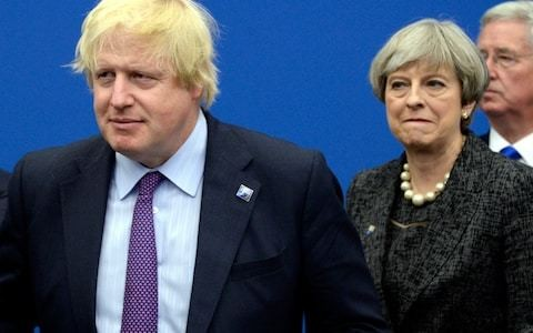 Theresa May appears to accuse Boris Johnson of being preoccupied with headlines rather than finding solutions