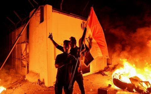 Iraq announces 'crisis cells' to crack down on protests after Iran consulate burned down