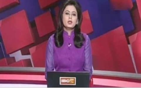 News presenter reads out breaking news of husband's death