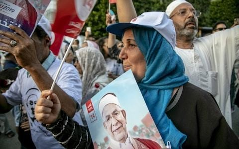 Disillusioned Tunisians vote in low numbers as shine of Arab Spring dulls
