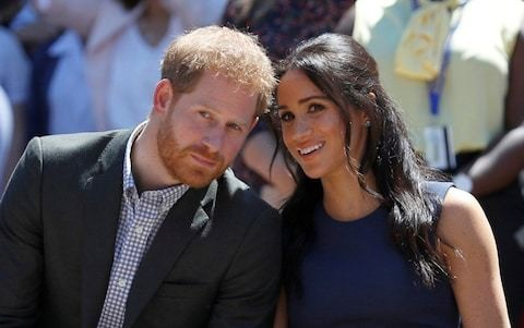 Prince Harry, Meghan and Archie land in South Africa - and get straight to work in 'murder capital' township