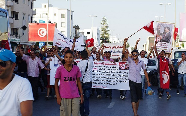 Tens of thousands take to streets in Tunisia to demand resignation of government