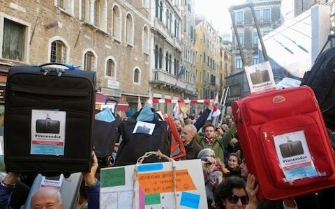 Venice's residents pack their bags in #Venexodus protest as tourism takes its toll on 'fragile' city