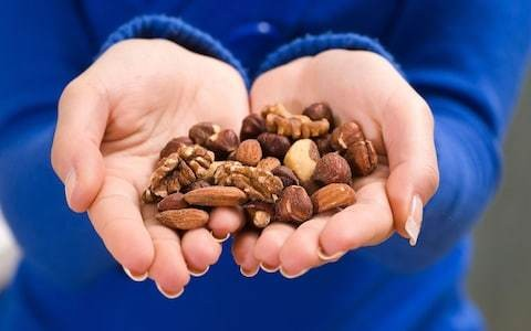 A handful of nuts a day could stave off middle aged spread