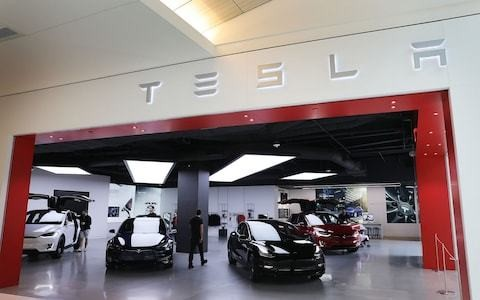 Tesla shrugs off Model 3 demand concerns with record delivery numbers