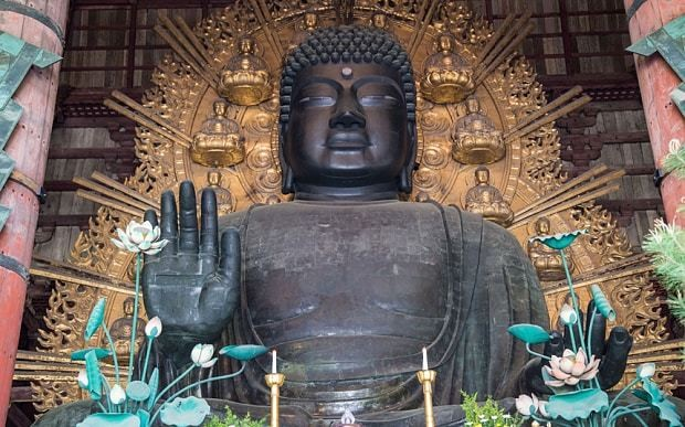 No one knows why an ancient Japanese Buddha statue lost half its hair curls