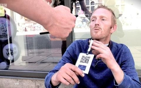 Homeless people wearing barcodes to accept cashless payments