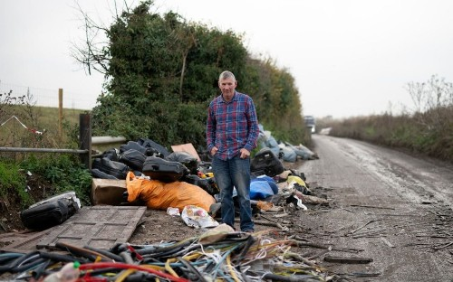 Farmers forced to fortify their land to defend against fly-tipping dumped by organised crime gangs