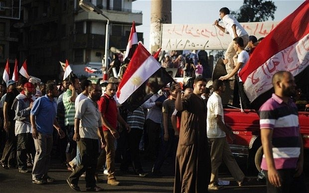 Egypt: Morsi supporters dig in for fight as authorities prepare to end protests