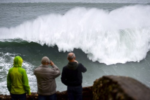 Big wave surfers ride monster swell off Praia do Norte, Portugal, in pictures - Telegraph