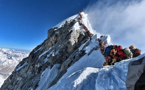 Three more climbers die amid Everest 'traffic jam'