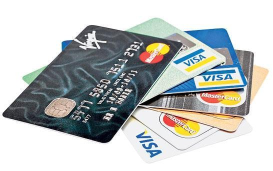 Travel firms accused over card fees