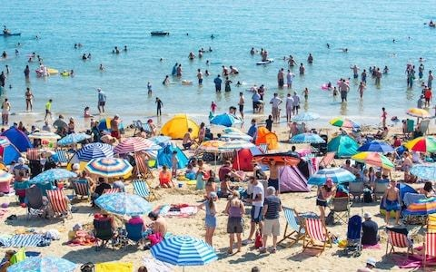 Britain will see four heatwaves a year and twice as many flash floods, 50 year forecast by Met Office predicts