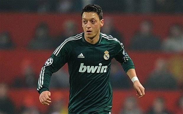 Mesut Özil joins Arsenal from Real Madrid in club-record £42 million deal