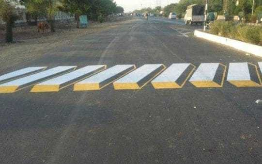 Authorities paint optical illusions on roads to slow drivers down