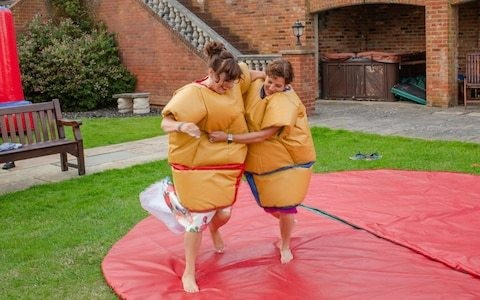 Wedding guest left paralysed after suffering stroke from sumo wrestling game at family reception