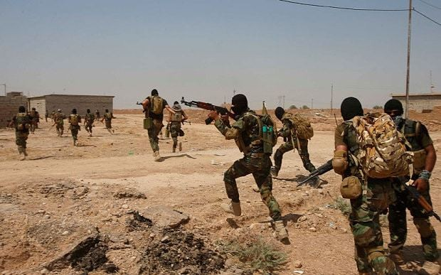 Iran-backed Shia militia says it will fight US Marines deployed to Iraq