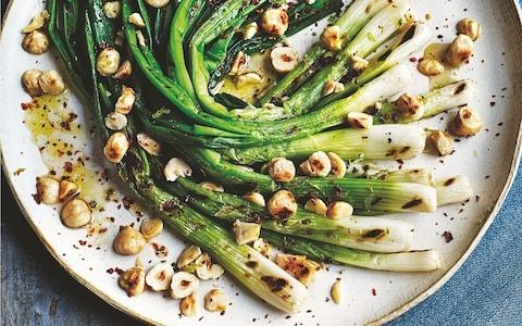 Chargrilled spring onions with hazelnuts and lime and honey dressing recipe