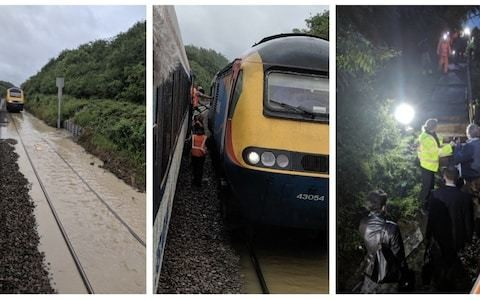 UK weather: Five hundred train passengers stranded on board for eight hours after tracks flood
