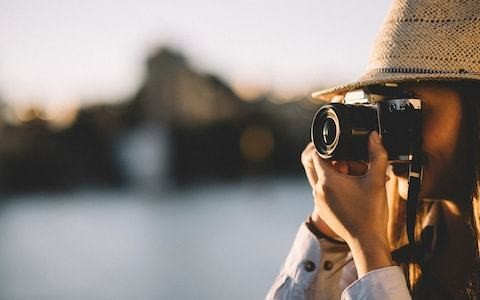 Why taking photographs is ruining your holiday – and everyone else's