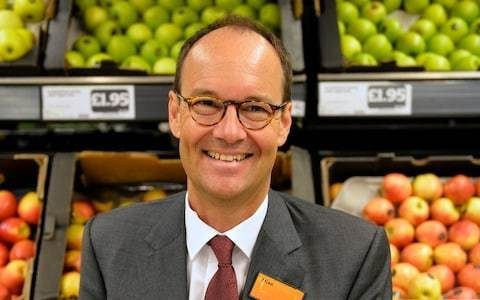 Sainsbury's boss confronted by activist over plastic packaging