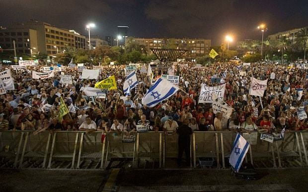 Gaza truce holding as 10,000 Israelis join protests in Tel Aviv