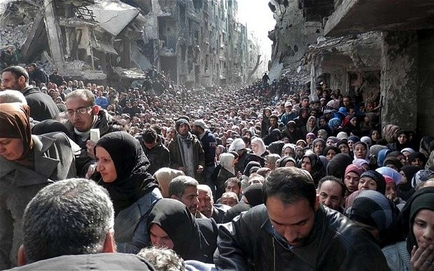 Al-Nusra siege of Yarmouk camp blocks aid to thousands of Syrians