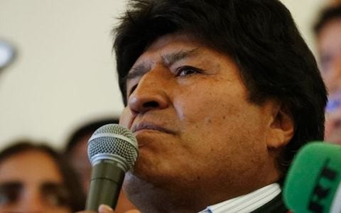 Evo Morales arrives in Mexico but vows to return to Bolivia 'with strength'
