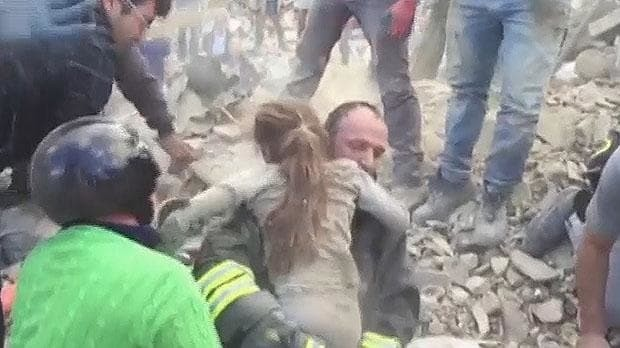 Italy earthquake: dramatic moment girl, 10, is pulled alive from rubble 17 hours after strike