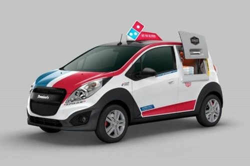 Domino's is starting to use cars with ovens in the back