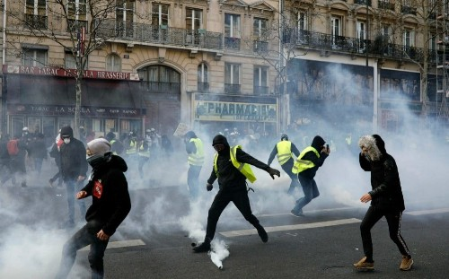 Police arrest 70 in 'yellow vest' protests as soldiers deployed to prevent Paris rioting