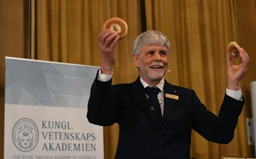 British scientists win Nobel prize in physics for work so baffling it had to be described using bagels