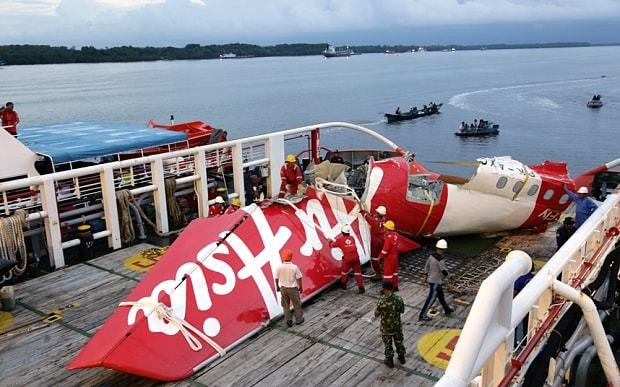 Pilots responding to malfuctioning plane part caused AirAsia crash which killed 162 passengers off Indonesia