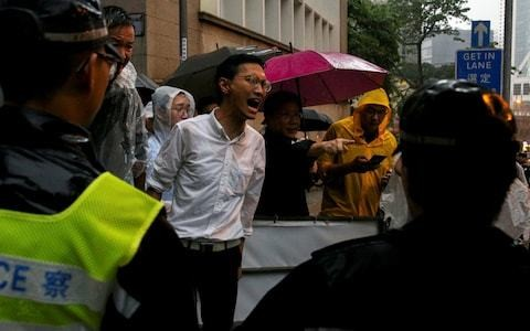 Hong Kong protesters attack Britain's response to erosion of rights as government shuts offices