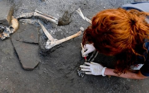 Pompeii dig finds intact skeletons of two women and three children huddled together