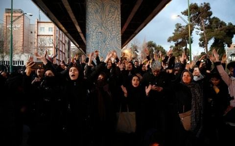 British ambassador to Iran arrested and held for several hours in Tehran after attending vigil