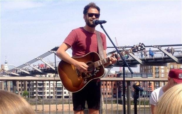 Passenger busks on London's South Bank
