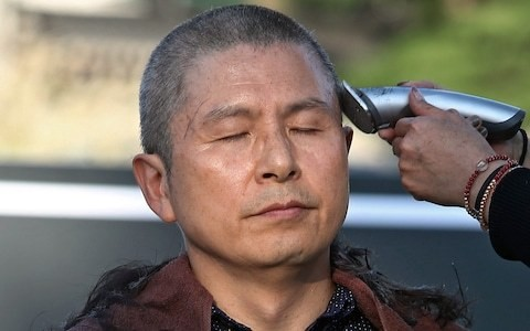 South Korea's educational privilege scandal widens after politicians shave their heads