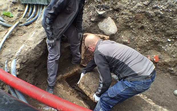 Hair-raising moment archaeologists open a 1,000-year-old coffin