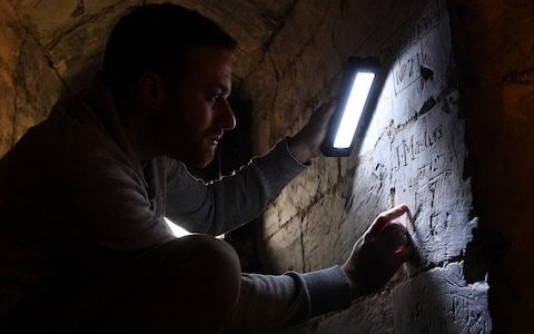 Medieval graffiti uncovered in a Hampshire church sheds new light on years after Black Death