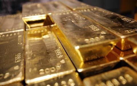 Gold hits five-year high after Federal Reserve hints at rate cuts