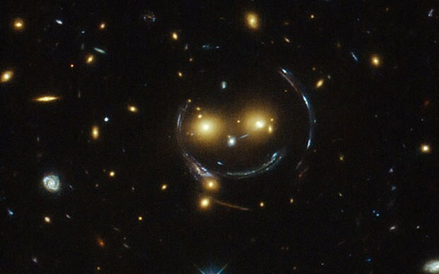 Hubble captures 'happy face' in space that smiles for the camera