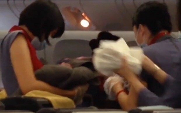 Woman who gave birth on plane 'deported from US to Taiwan without baby'
