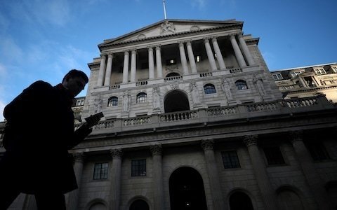 Bank of England gloomier on growth but refuses to join Fed in cutting rates