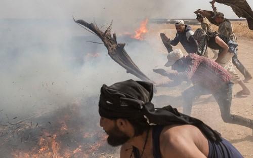 Photo Dispatch: Syrian farmers battle raging crop fires