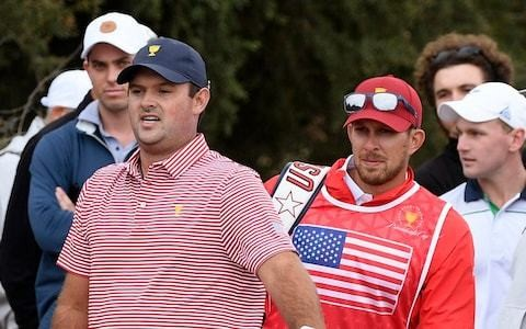 Patrick Reed's caddie banned from remainder of Presidents Cup after pushing spectator